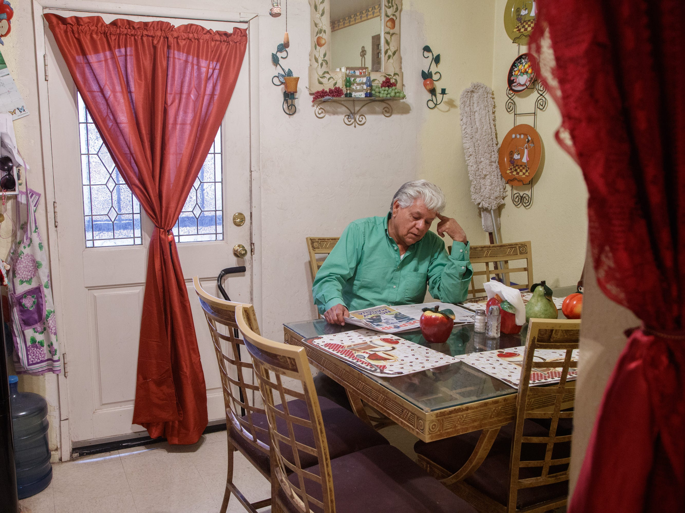 Antonio Ramírez reads the newspaper at his home in Calexico.