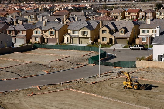 Home construction continues at a housing development where building had been dramatically slowed during the recession on December 22, 2009 in Santa Clarita, California.