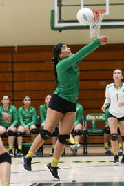 Coachella Valley's Elina Corona saves the ball from going out of bounds against Cathedral City.