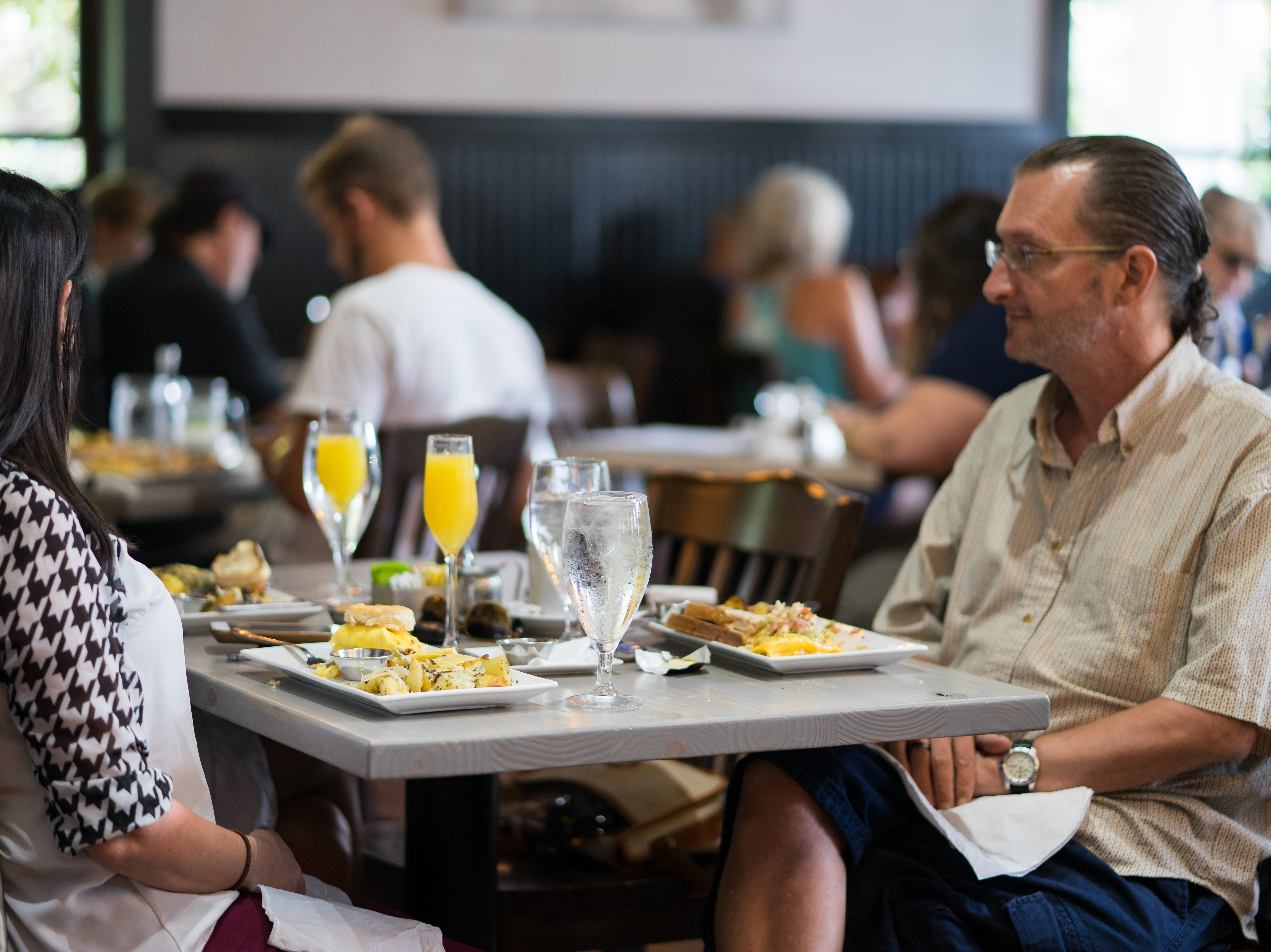 Tripp Wogan, right, and Jennifer Miller sit down for a Friday brunch at the newly reopened George Bistro + Bar on Sept. 28, 2018.