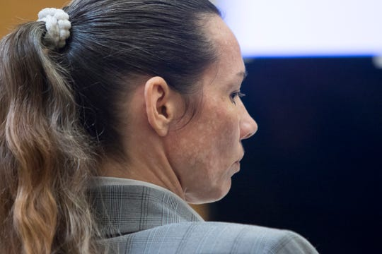 Mary Rice listens as prosecutor Bridgette Jensen gives her closing statements during her trial at the Escambia County Courthouse in Pensacola on Friday, September 28, 2018.