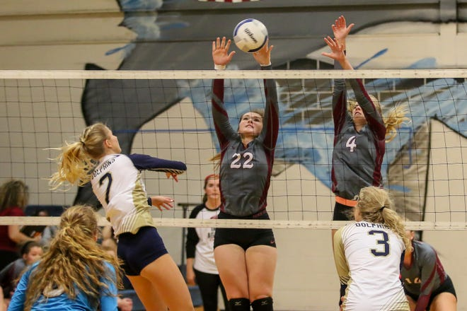 Tate's Karen Hill (22) and Madison Hatch (4) go up to block a shot by Gulf Breeze's Carlee Amberson (2) in a District 1-8A matchup at Gulf Breeze High School on Thursday, September 27, 2018.