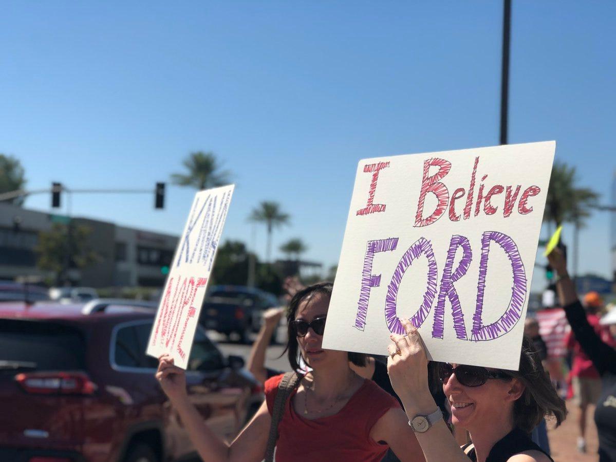 People protest outside Sen. Jeff Flake's Phoenix office on Sept. 28, 2018.