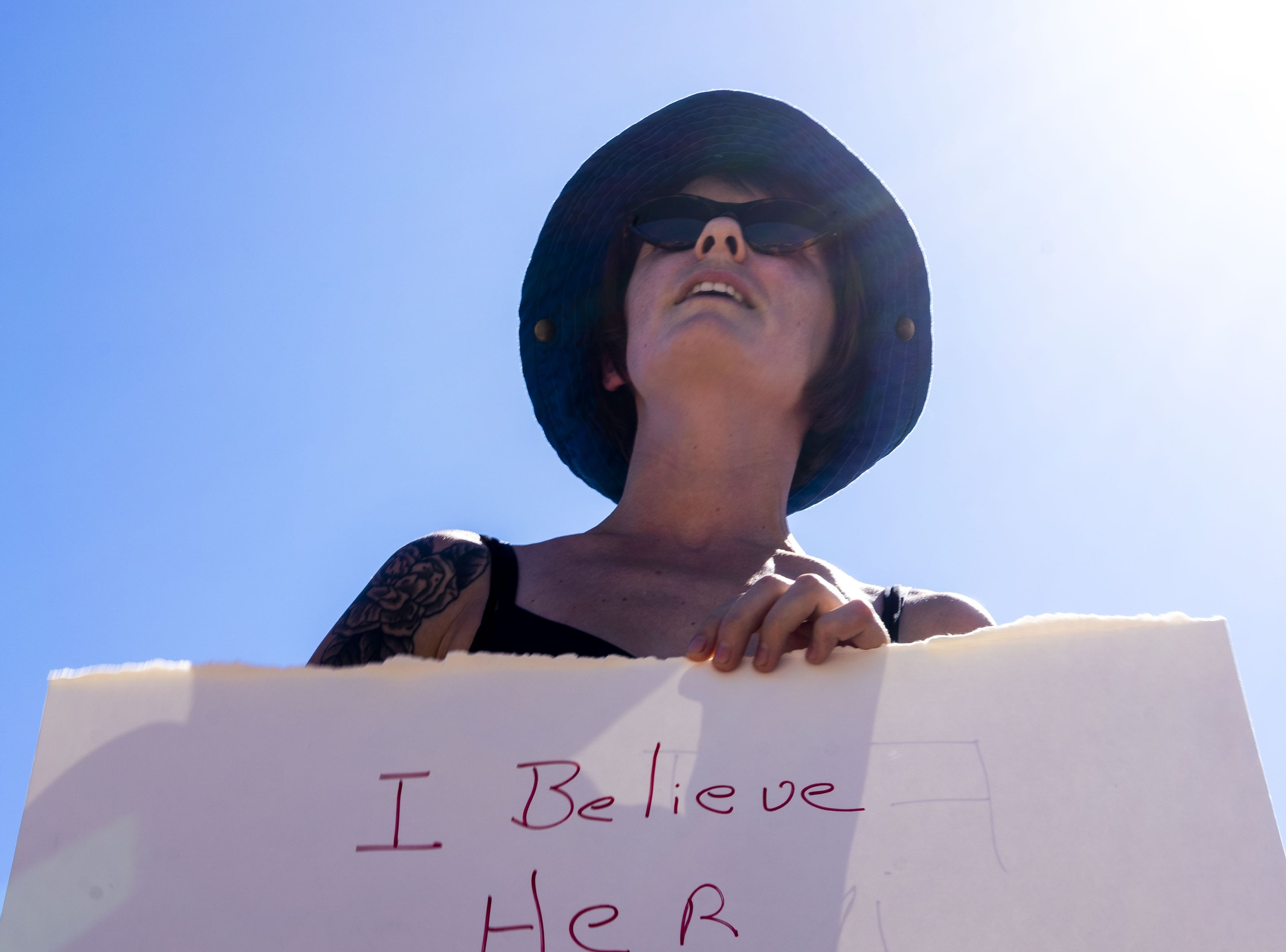 Tauni Malmgren protests Sept. 28, 2018, outside of Jeff Flake's office in Phoenix after he said he wouldn't support a U.S. Senate floor vote for Judge Brett Kavanaugh's Supreme Court confirmation without first allowing an FBI investigation into sexual harassment accusations against Kavanaugh.