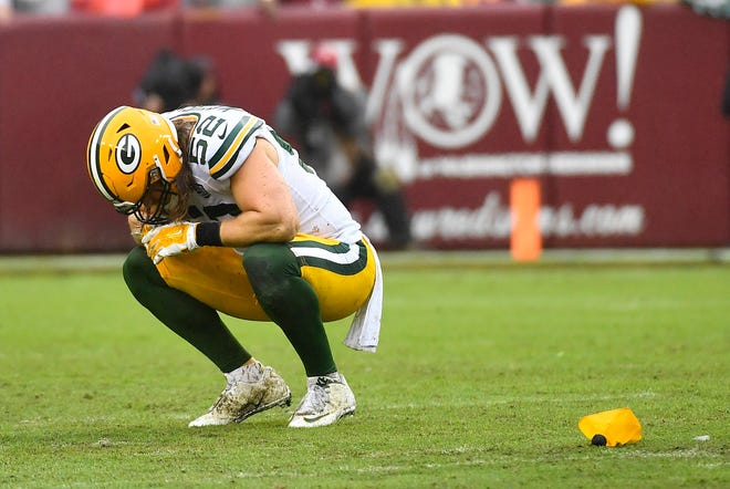 Packers linebacker Clay Matthews (52) reacts after being flagged for roughing the passer on a sack of Redskins quarterback Alex Smith.