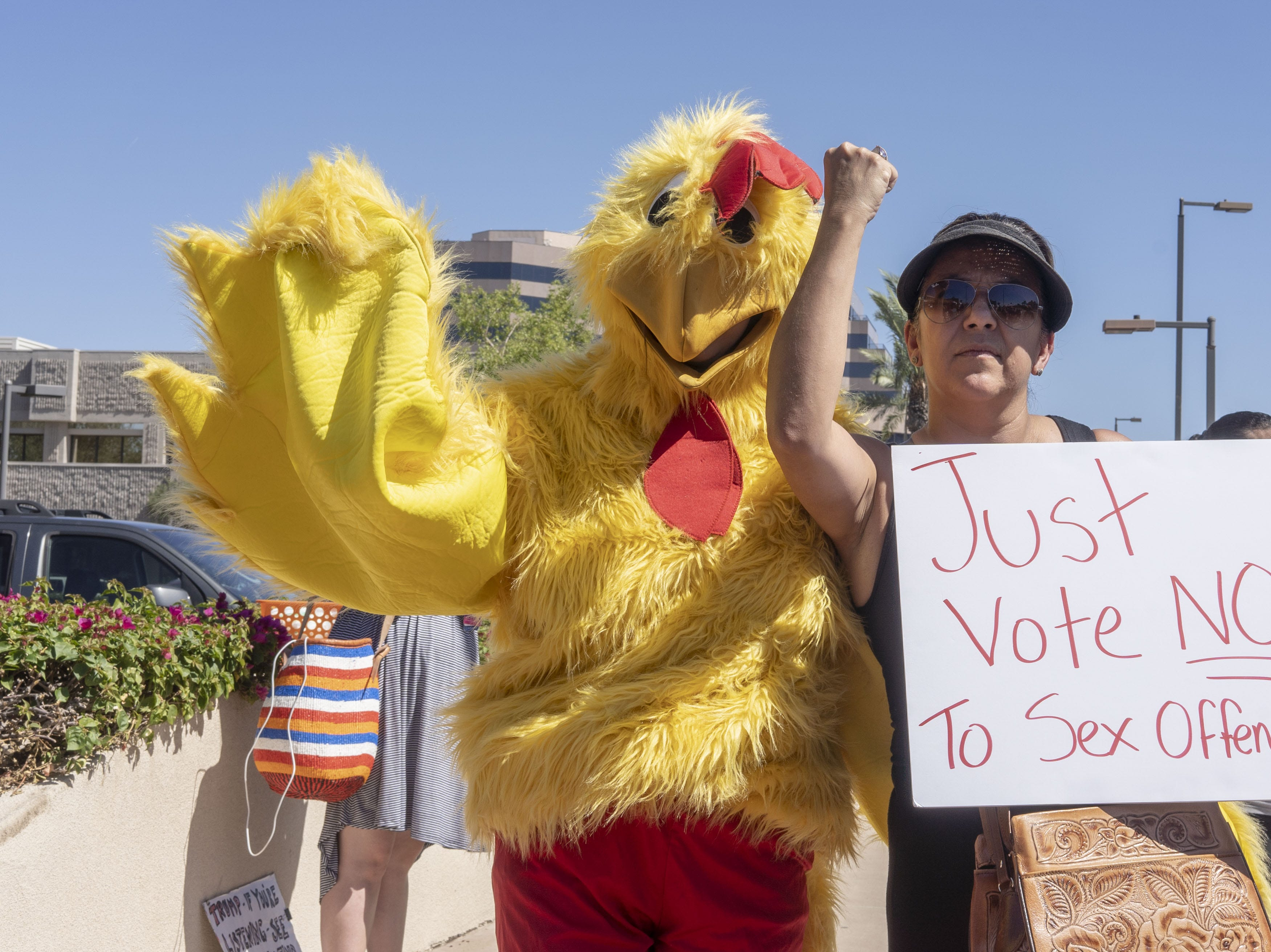 Protesters march outside Jeff Flake's office in Phoenix on Sept. 28, 2018. Flake said he wouldn't support a floor vote for Judge Brett Kavanaugh U.S. Supreme Court confirmation without allowing an investigation into sexual harassment accusations against Kavanaugh.