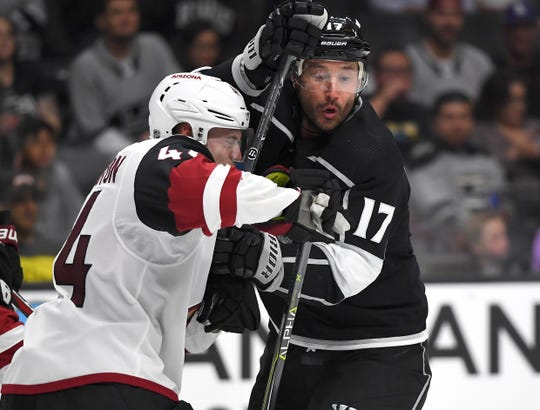Kings left wing Ilya Kovalchuk (17) mixes it up with Coyotes defenseman Kevin Connauton (44) during the second period of a preseason game at Staples Center.