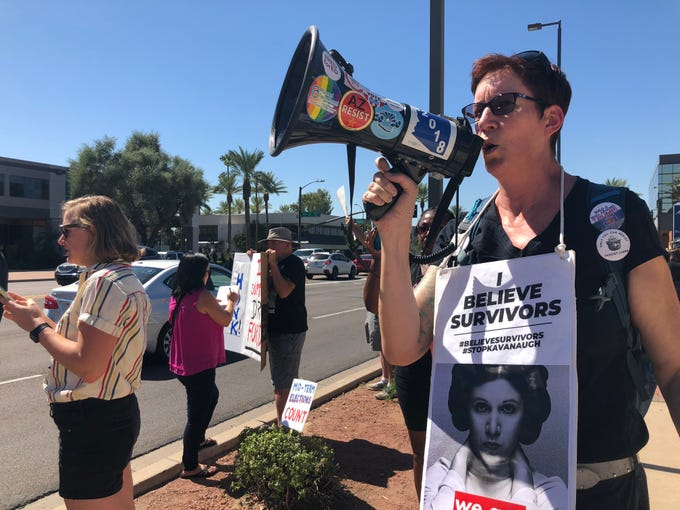 Protesters gather outside Sen. Jeff Flake's office in Phoenix on Sept. 28, 2018, as the Senate Judiciary Committee voted to recommend Brett Kavanaugh's Supreme Court nomination to the full Senate.
