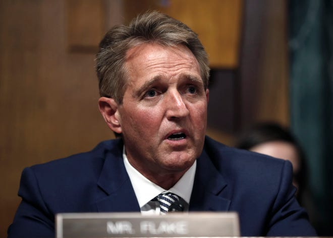 Sen. Jeff Flake, R-Ariz., speaks before the Senate Judiciary Committee hearing about an investigation, on Sept. 28, 2018, on Capitol Hill in Washington, D.C.