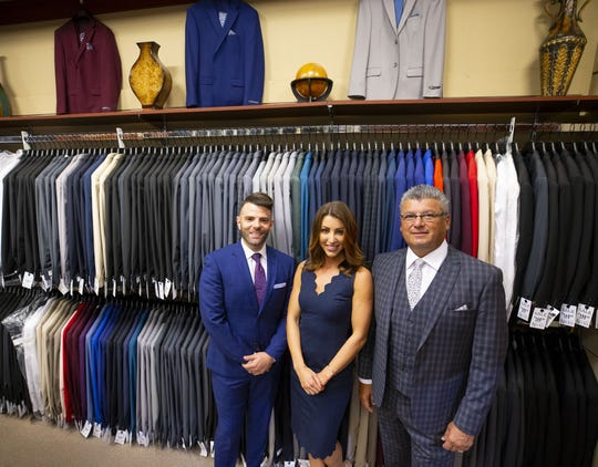 Mitch Fink, right, owns Nick's Menswear in Chandler Fashion Center. Fink works with his nephew, Josh, left, and daughter, Michelle. The family-owned and operated business specializes in proms and weddings.