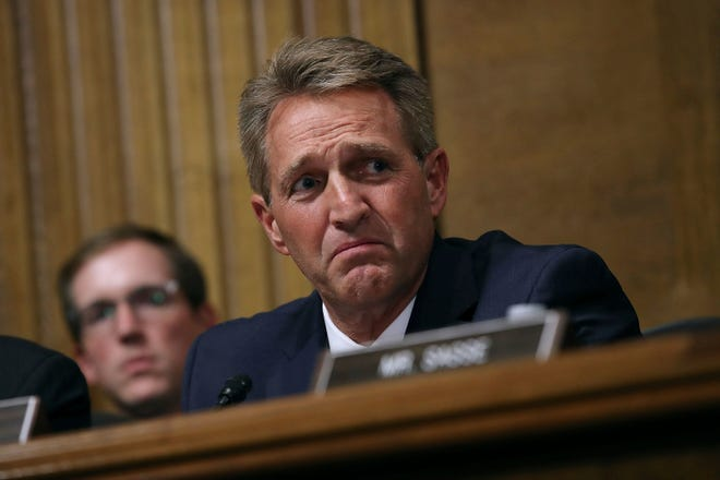 Sen. Jeff Flake, R-Ariz., listens as Supreme Court nominee Brett Kavanaugh testifies before the Senate Judiciary Committee on Capitol Hill in Washington on Sept. 27, 2018.