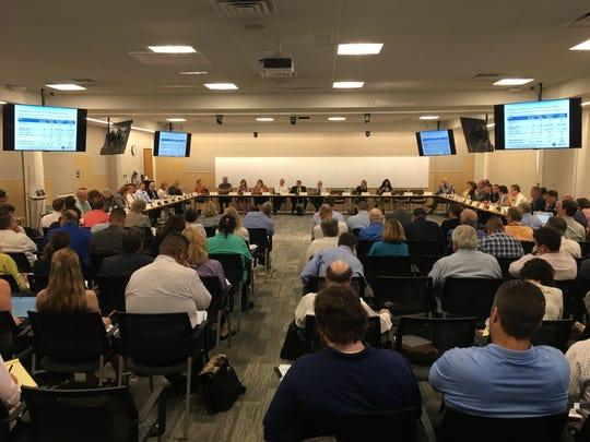 Steering-committee members discuss steps toward a proposed drought-contingency plan on Sept. 27, 2018, at the Central Arizona Project headquarters in Phoenix.