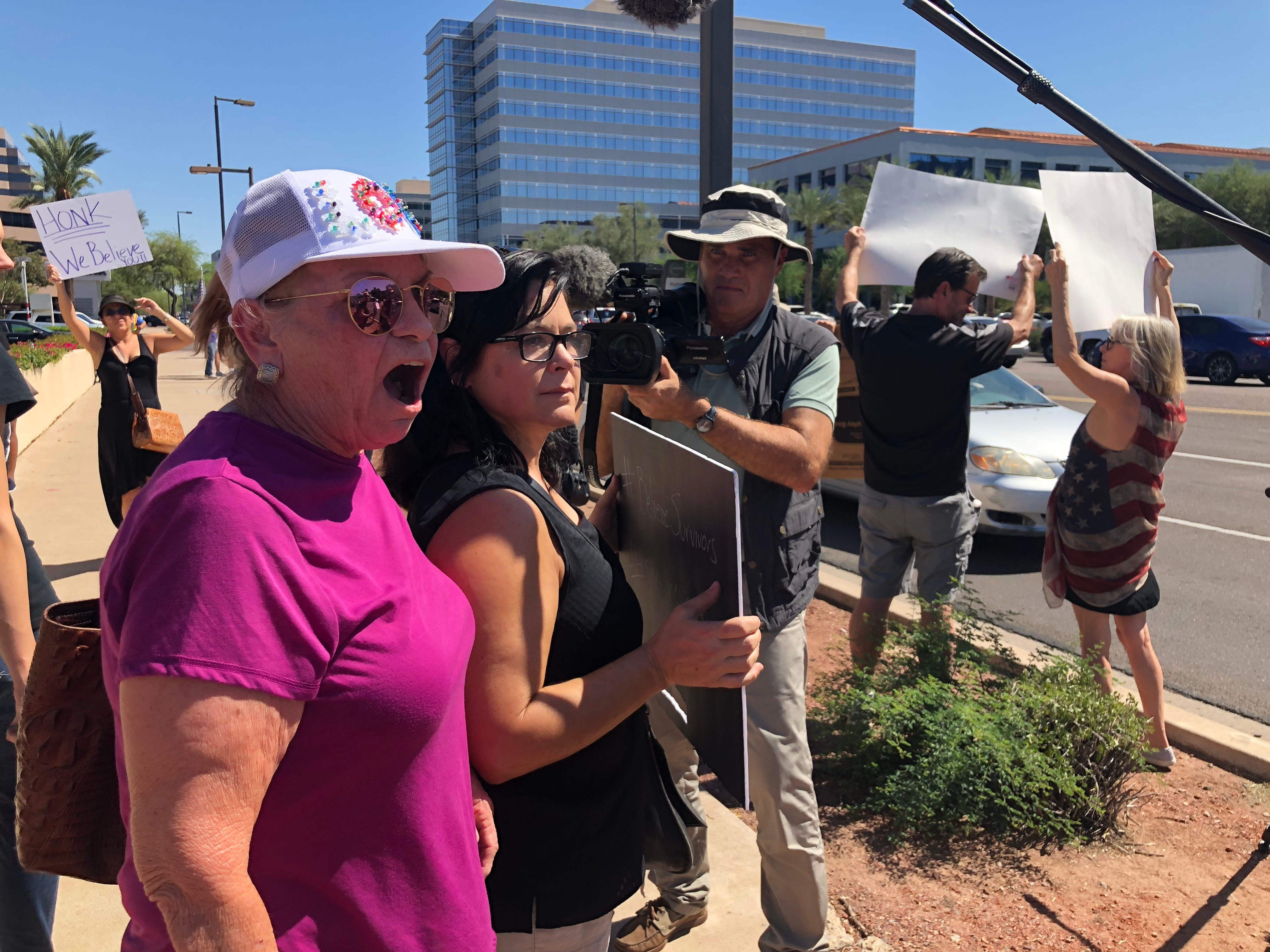Protesters gather outside Sen. Jeff Flake's office in Phoenix on Sept. 28, 2018, as the Senate Judiciary Committee voted to recommend Brett Kavanaugh's Supreme Court nomination.