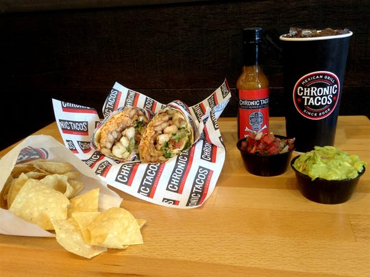 Provided by Chronic Tacos A fish burrito, chips, salsa, guacamole and hot sauce at Chronic Tacos. A fish burrito, chips, salsa, guacamole, a bottle of Chronic Tacos ghost pepper hot sauce and a drink.