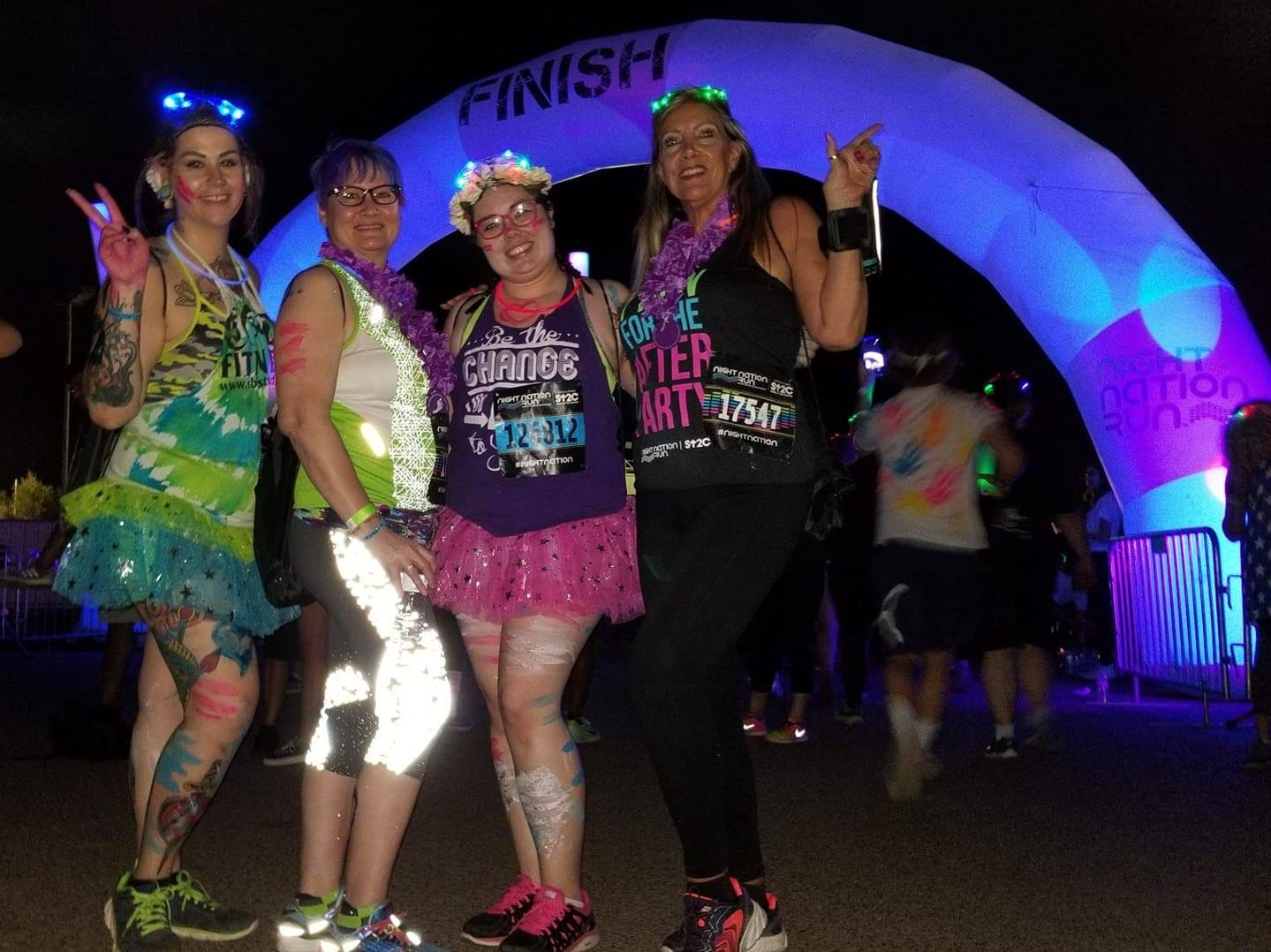 "Audra Araujo, 27, of Phoenix, (far left) at a past race with friends. She and four friends recently purchased $20 tickets to the ""Dragon, Zombies, Skull Run,"" which turned out to be a scam."