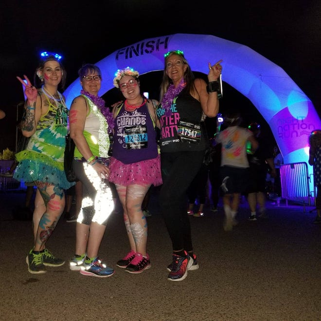 """Audra Araujo, 27, of Phoenix, (far left) at a past race with friends. She and four friends recently purchased $20 tickets to the """"Dragon, Zombies, Skull Run,"""" which turned out to be a scam."""
