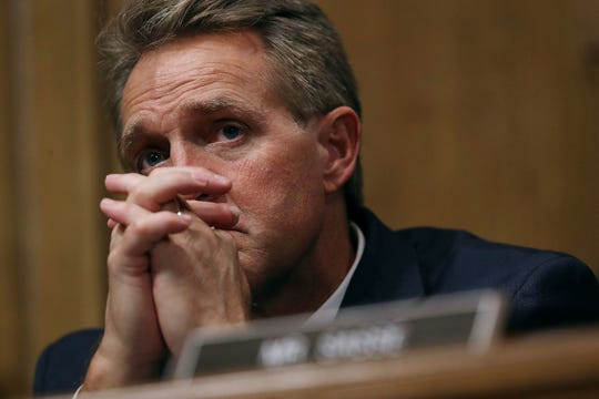 Sen. Jeff flake, R-Ariz., listens as Christine Blasey Ford testifies before the Senate Judiciary Committee on Sept. 27, 2018, in Washington, D.C.
