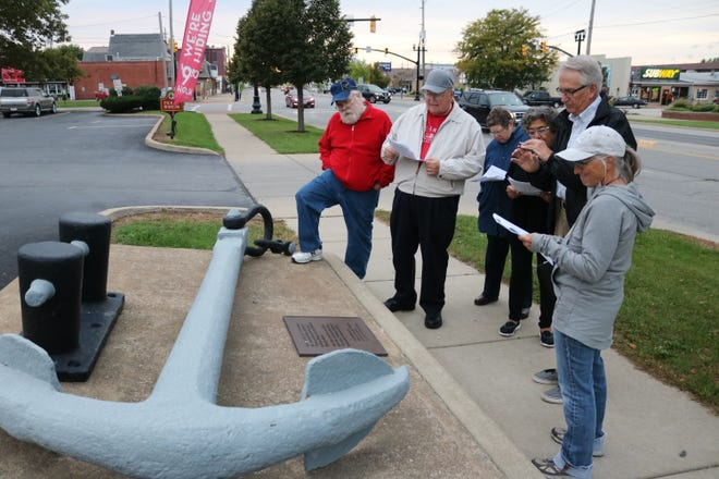 A group of locals on a historical walking tour downtown stop to check out this anchor from a 1900 shipwreck at Niagara Reef off Port Clinton. The anchor now sits at the site of the former Lake House Hotel.