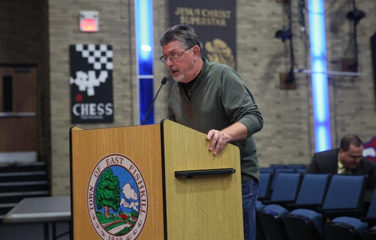 Gerard McVicker speaks to the town board during the meeting on Thursday night. He said he's concerned about the impact the possible Copart site could have on the property values of homes.