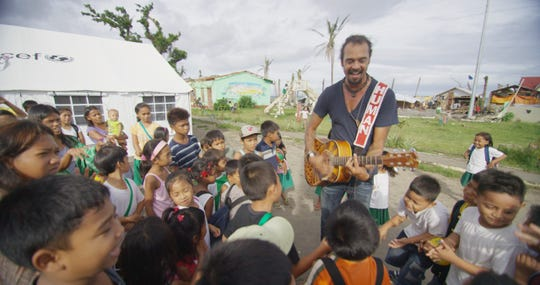 """A scene from """"Stay Human,"""" a documentary featuring musician Michael Franti that will be shown at the Woodstock Film Festival."""
