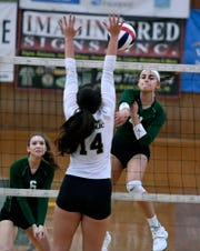 York Catholic's Hope Leavy-Gaskins is seen here hitting a kill against Delone Catholic last season. Leavy-Gaskins had 15 kills on Tuesday night in York Catholic's 3-0 win over Delone.