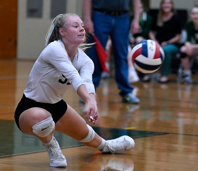 York Catholic libero McKenna Walker digs deep to return a Delone Catholic serve earlier this season. John A. Pavoncello photo