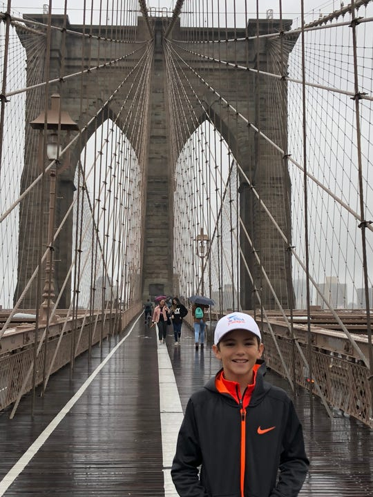 """Seth Erdley, a Northeastern eighth-grader starring in the national tour of   Broadway's """"Finding Neverland"""" this season, takes his day off from rehearsal to explore the Brooklyn Bridge in New York City."""