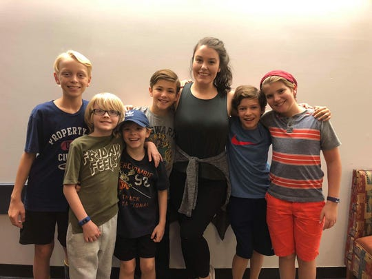 "Northeastern eighth-grader Seth Erdley, fourth from left, and his five co-stars share the roles of three brothers in Broadway's ""Finding Neverland,"" touring nationally in the 2018-19 season. The boys pose with their characters' mother, Sylvia, played by Ruby Gibbs."