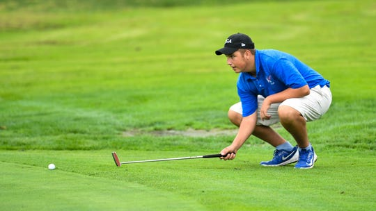 Spring Grove's Karl Frisk visualizes the putt during the YAIAA league individual golf tournament, Thursday, September 27, 2018.