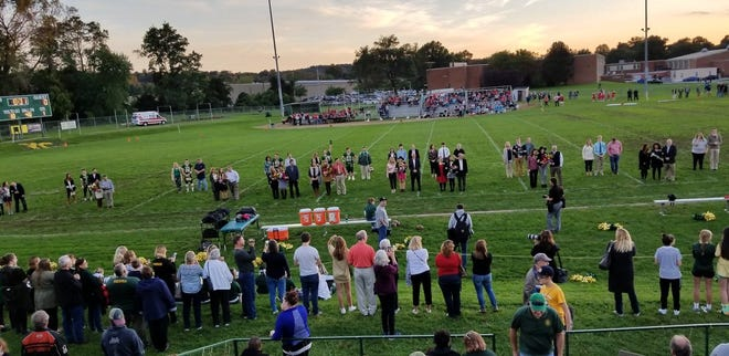Ethan Higgins is homecoming king of York Catholic, and the queen is Alexis Baum.