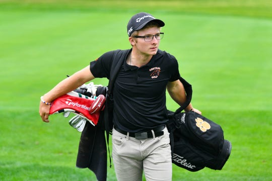 Central York's Carson Bacha prepares to set his bag down during the YAIAA league individual golf tournament at Briarwood Golf Club, Thursday, September 27, 2018.
