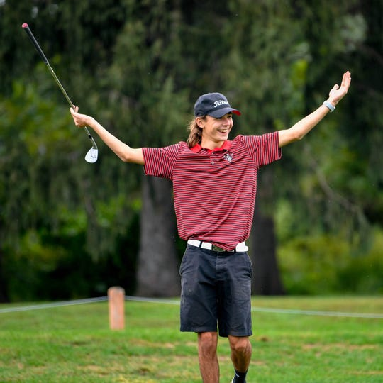 Spencer Beran celebrates after sinking a long shot from the rough during the YAIAA league individual golf tournament at Briarwood Golf Club, Thursday, September 27, 2018.