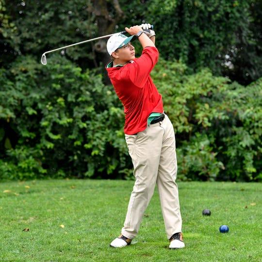 York Catholic's Nolan Wisniewski tees off during the YAIAA league individual golf tournament at Briarwood Golf Club, Thursday, September 27, 2018.