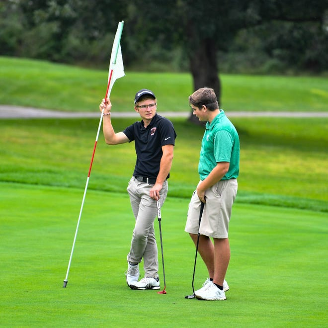 Carson Bacha of Central York (left) discusses the last hole with Russ McPaul of York Catholic (right) during the YAIAA league individual golf tournament at Briarwood Golf Club, Thursday, September 27, 2018.