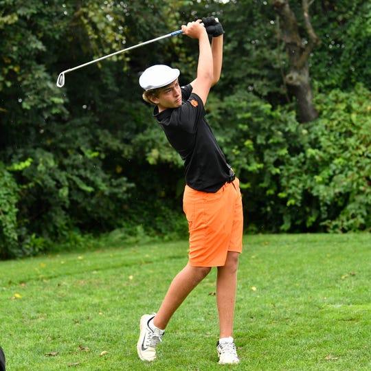 Central York's Alex Gekas follows through during the YAIAA league individual golf tournament, Thursday, September 27, 2018.