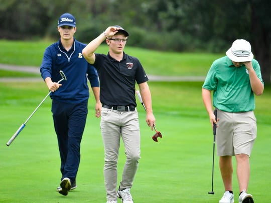 Littlestown's Devin Peart (left), Central York's Carson Bacha (middle) and York Catholic's Russ McPaul (right) head back to their bags after a tough hole at the YAIAA league individual golf tournament, Thursday, September 27, 2018.