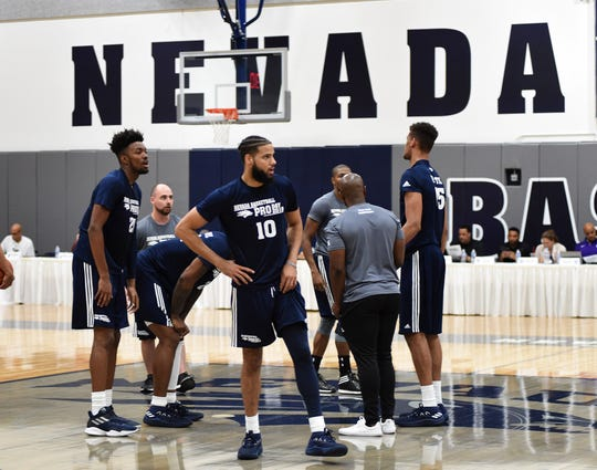 Nevada basketball players show off their skills in front of scouts during Wolf Pack Basketball Pro Day at Nevada on Thursday.