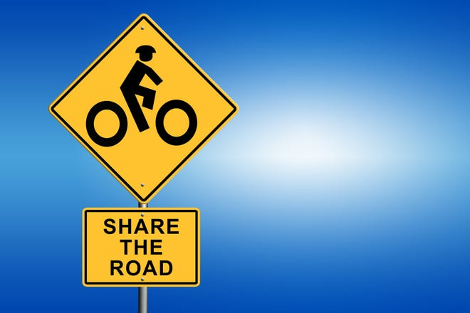 Bike Road Sign - Share The Road with blue background