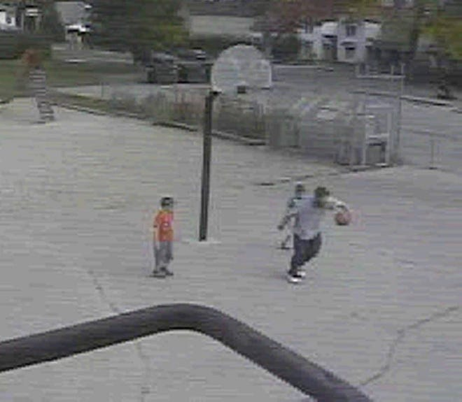Richmond police investigators want to speak with this man seen in video surveillance footage playing basketball with two kids at Starr Elementary School on Oct. 22, 2015.