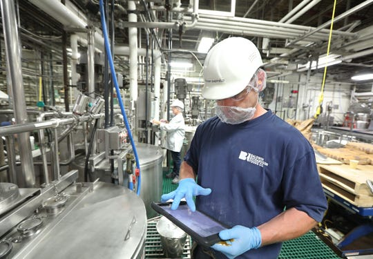 Jeremy Sheffield, right, and Tina Boudrieau work on the production floor at Baldwin Richardson Foods Co. in Macedon.