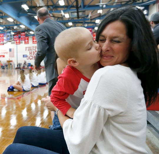 Julianna Monacelli gets a kiss from her son Wyatt, 4, who has acute lymphoblastic leukemia, during a pep rally at Fairport High School.