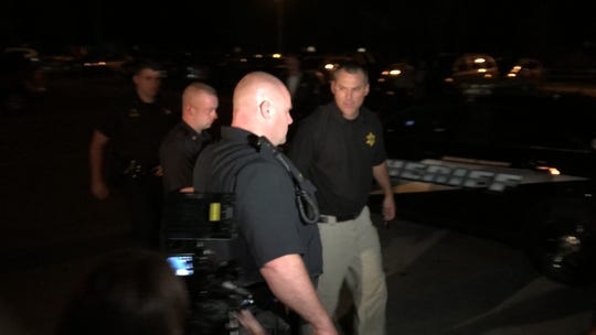 Mason Earle, 19, is led into Hamlin Town Court Thursday night prior to his arraignment. He is accused of killing Bruce Kane and Alexander Burrow.