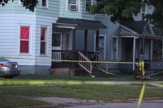 A man was fatally shot outside 387 Glenwood Ave. Rochester Police kept the block surrounding the shooting site blocked off the next day.