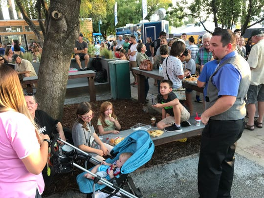 Jackie Munns, left, and her three kids, Trinity, 9, Madilyn, 7, Connor, 11, nephew Dominik, 5 months and husband Courtney attended the opening night of The Park food truck event at Carnegie Park in downtown Redding.