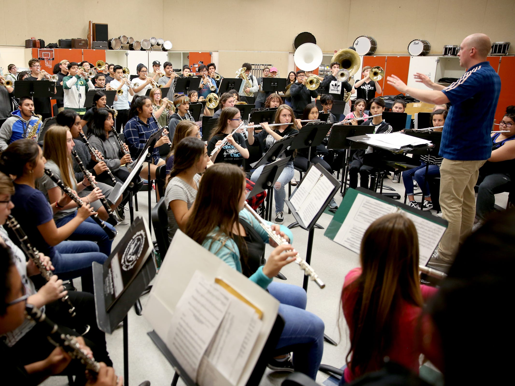 The McKay marching band rehearses music inside at McKay High School in Salem on Thursday, Sep. 27, 2018.