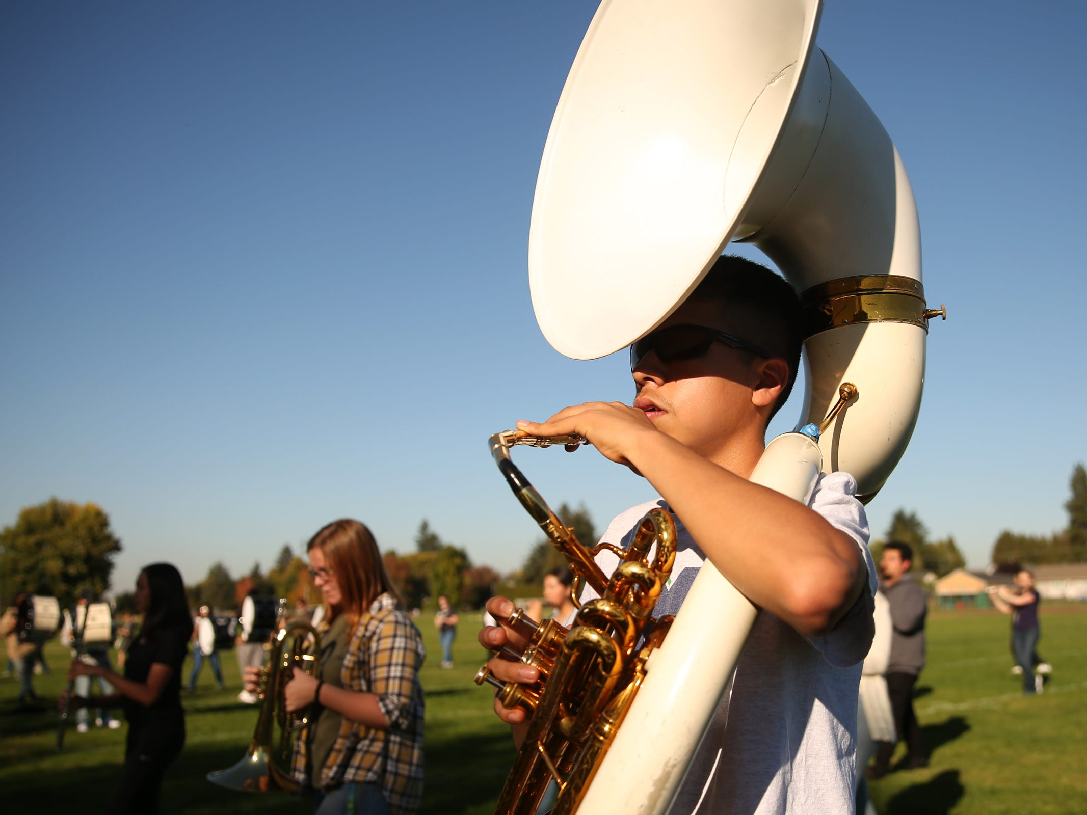 A McKay marching band sousaphone player rehearses at McKay High School in Salem on Thursday, Sep. 27, 2018.