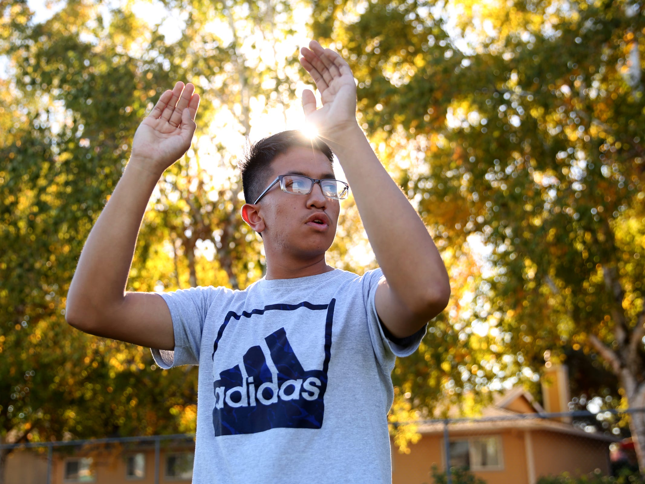 Alex Lazaro Ortiz, a senior drum major, conducts during a McKay marching band rehearsal at McKay High School in Salem on Thursday, Sep. 27, 2018.