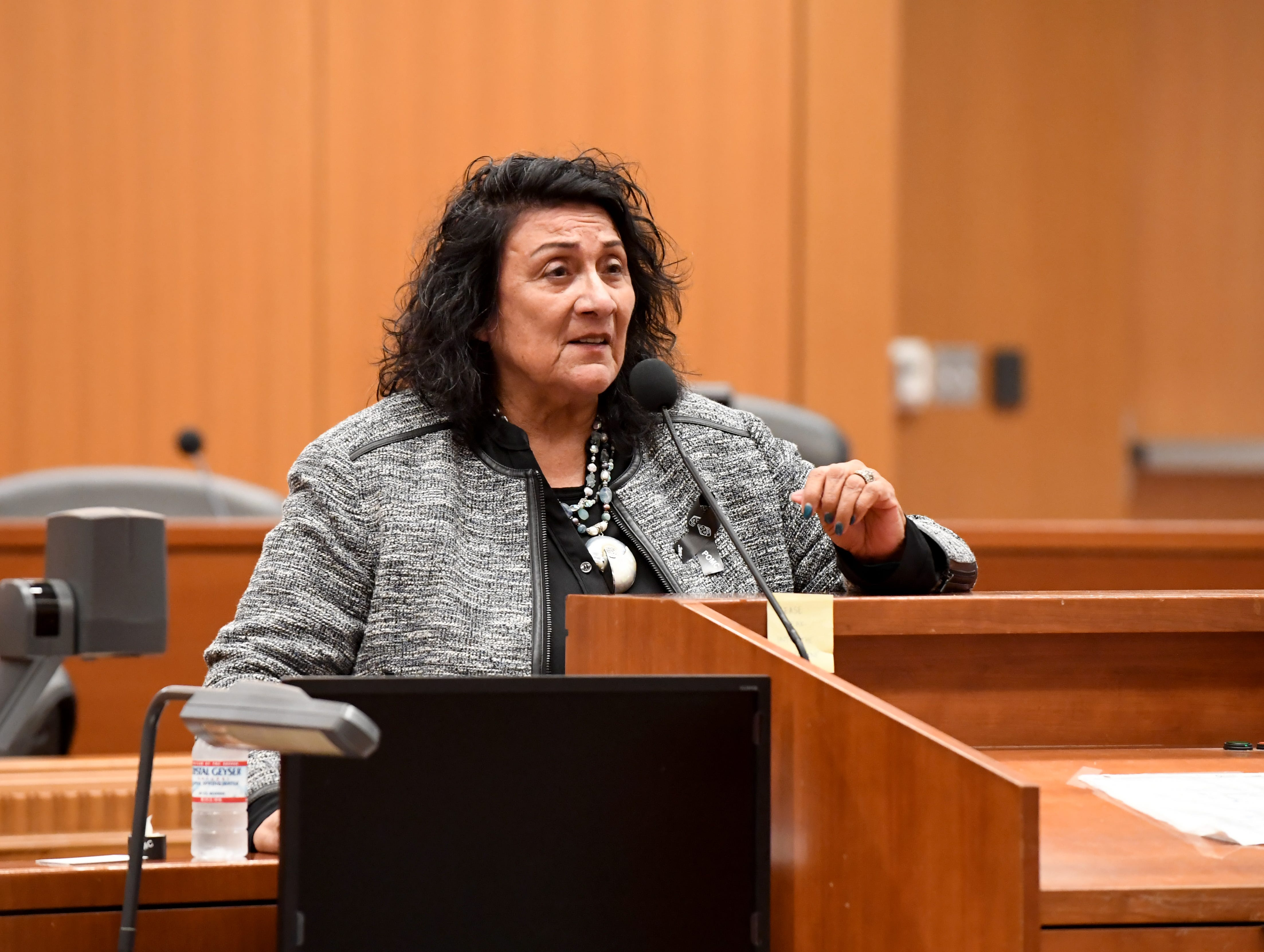 Angie Ortega, president of the local chapter for Parents of Murdered Children, Inc., addresses the crowded during the National Day of Remembrance for Murder Victims Thursday. Her daughter Lorraine was killed in 1993.
