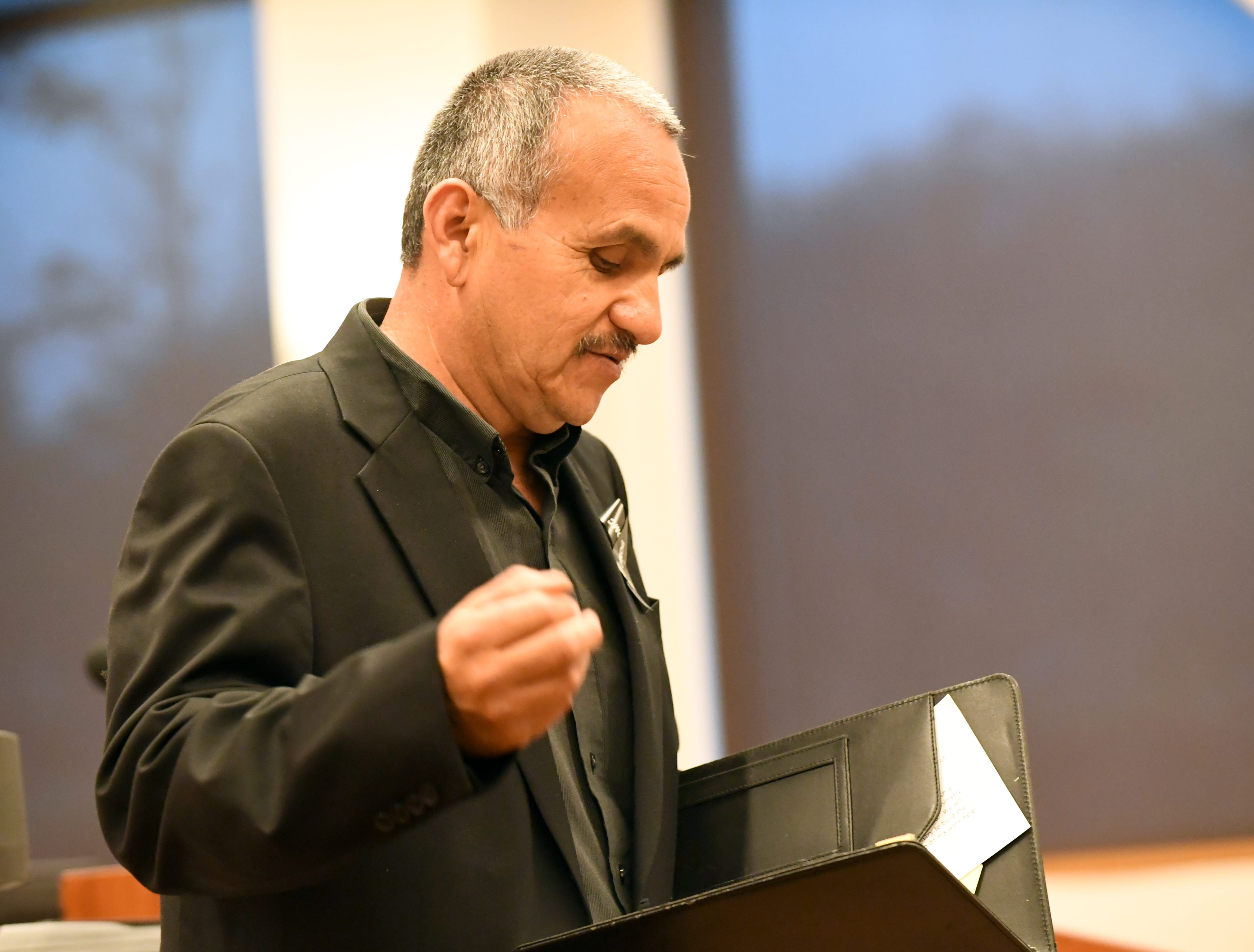 Pastor Randy Ponce delivers the invocation during the National Day of Remembrance for Homicide Victims ceremony.