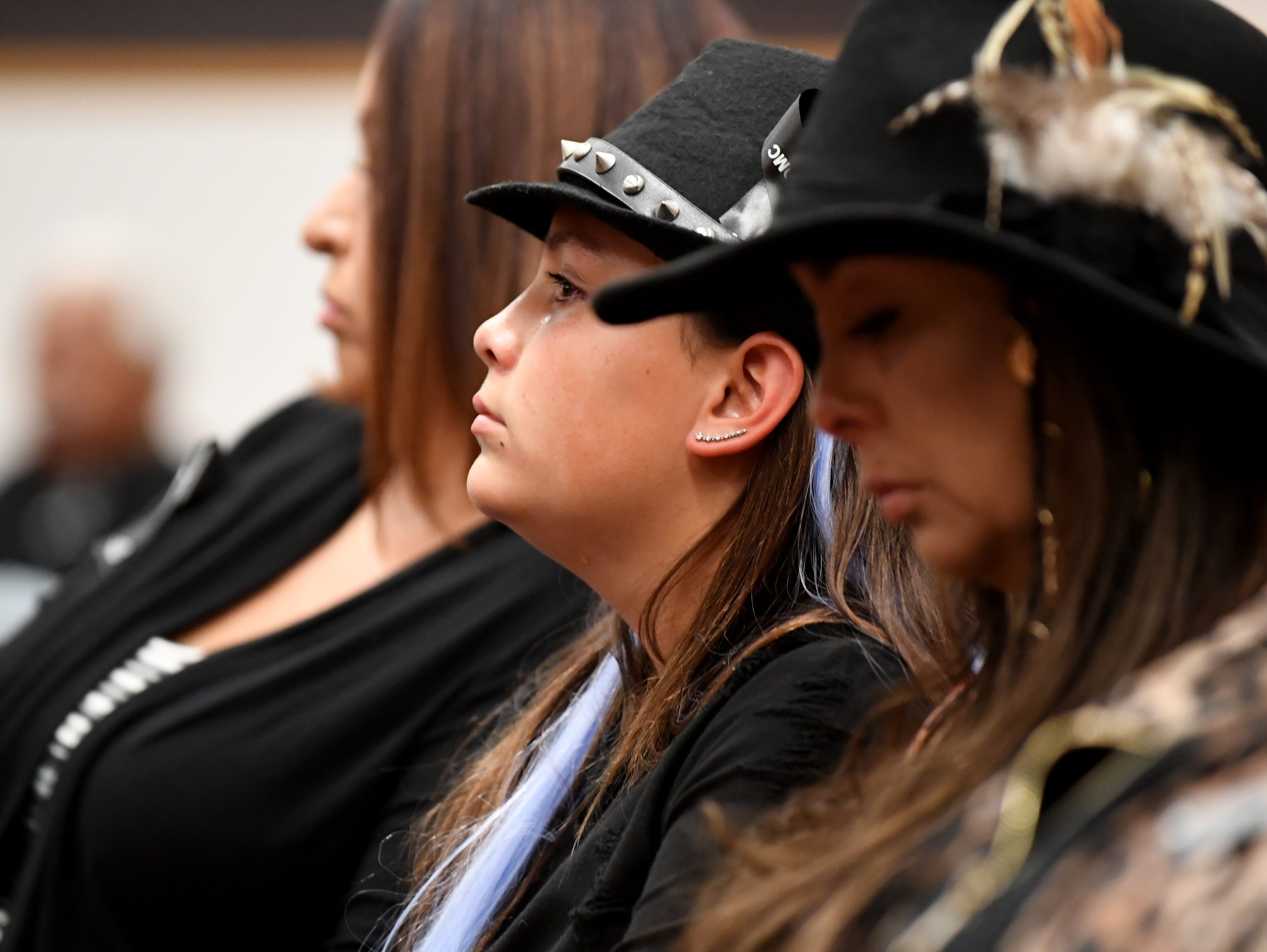 Meiha Vargas (middle) mourns her uncle Sal Vargas who was killed when he was 18.